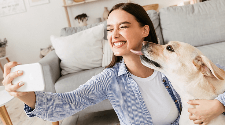 Woman taking selfie with dog
